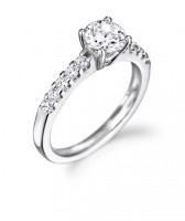 Brilliant cut diamond and shoulder set engagement ring
